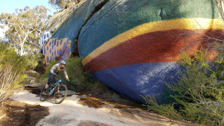Shane so fast (so blurred) riding passed the famous touty painted rock