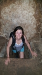 Kate climbing through the Cu Chi tunnels