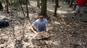 Shane going in a hidding hole at the Cu Chi Tunnels