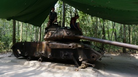 Shane on a tank remains at the Cu Chi Tunnels